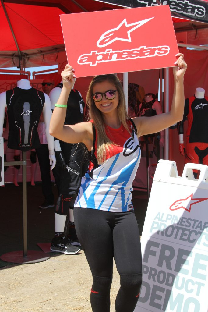ALPINESTARS GALS WERE BRINGING IN THE CROWDS TO THE BOOTH