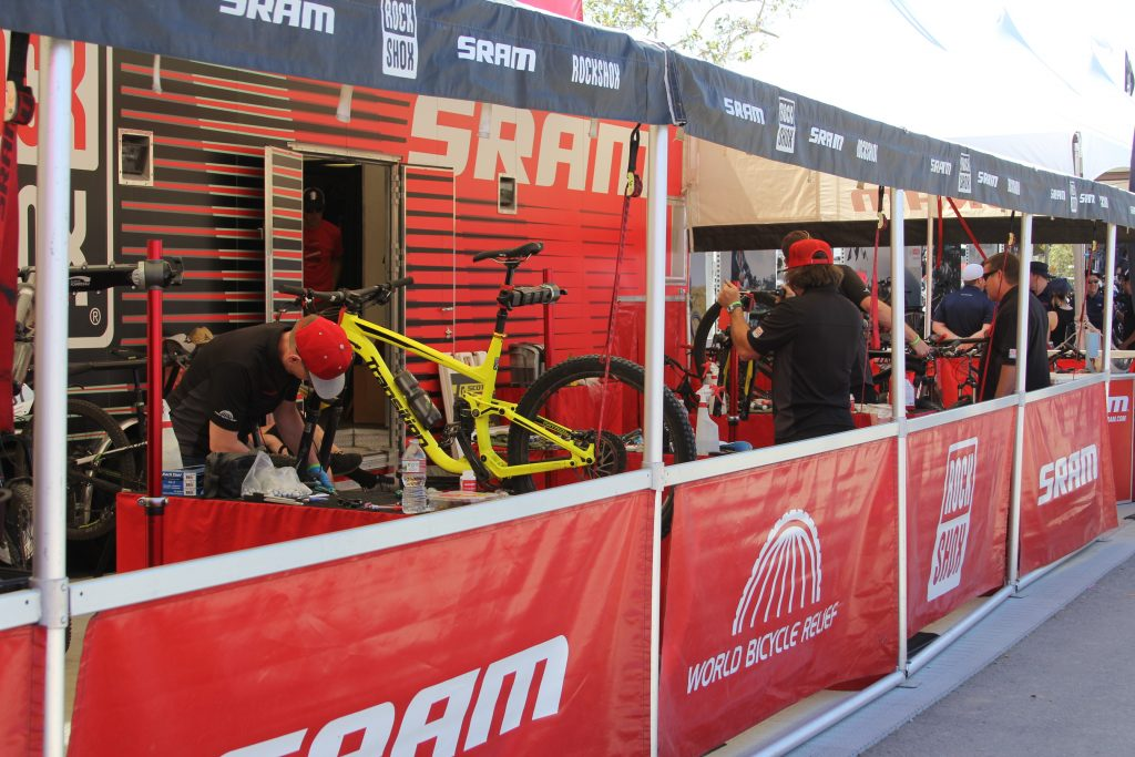 THE SERVICE BOOTHS LIKE SRAM ARE ALIVE WITH NONE STOP SERVICE. THESE GUYS ARE ON TOP OF IT TO KEEP THE RACERS GOING.