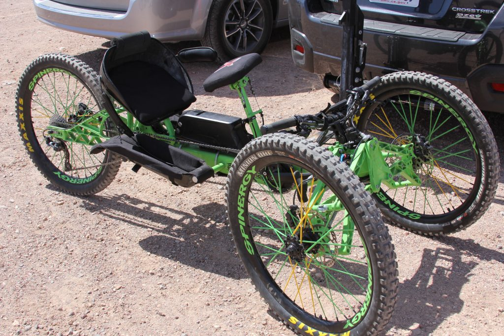 HERE'S ONE BADASS RIG. FULL SUSPENSION, DISC, HAND CRANK, AND E-BIKE CAPABLE.