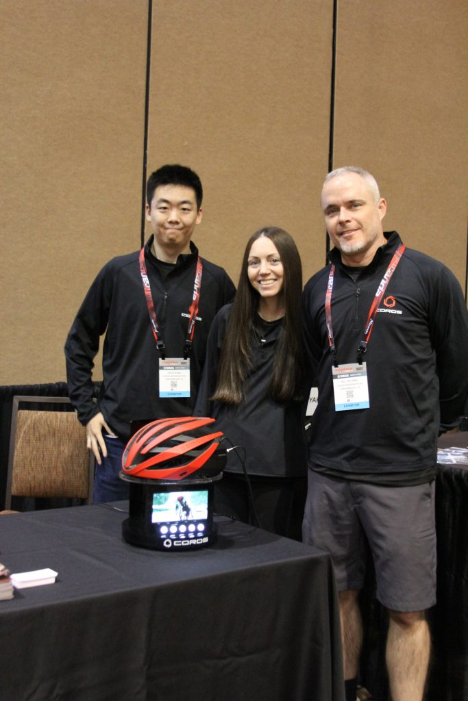 THE COROS CREW SMILING WITH PRIDE SHOWING THEIR BLUETOOTH ROAD HELMET
