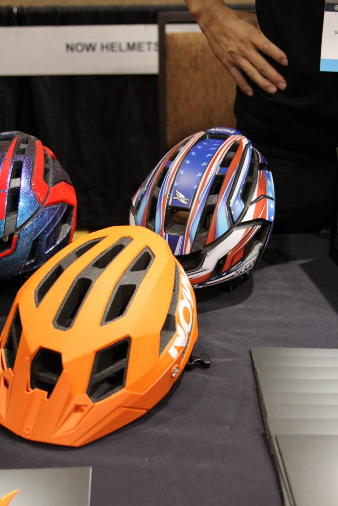 "A NEW HELMET COMPANY ON THE MARKET IS ""NOW"" HELMETS. THEY HAVE A COOL LOOK WITH GOOD AIR FLOW FROM THE LOOK OF IT."
