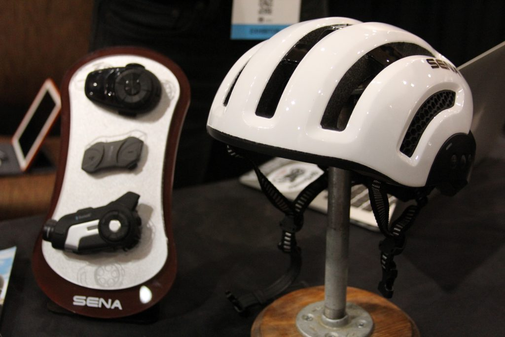 IF YOU RIDE MOTORCYCLES ON THE STREET, THEN CHANCES ARE YOU HAVE HEARD OF SENA. SENA HAS BEEN MAKING COMMUNICATION SYSTEM FOR THE MOTORCYCLE INDUSTRY FOR AWHILE NOW, THEY ARE CONSIDERED ONE OF THE TOP SYSTEMS.  WE DIDN'T KNOW THIS, BUT THEY ARE NOW ENTERING INTO THE CYCLING INDUSTRY. LIKE A FEW OUT THERE SENA IS MAKING THEIR SYSTEM BLUETOOTH CAPABLE WITH YOUR SMART PHONE. TAKE A CALL, MAKE A CALL, HEAR SOME MUSIC, OR GET TURN BY TURN INSTRUCTIONS. WOW SOUNDS KIND OD GOOD TO ME.